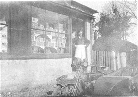 Photo:William Miller at the door of his shop, Millers Stores. Town Green Road, Orwell, 1923-27